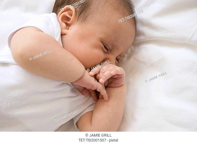 Baby girl (2-5 months) sleeping in bed