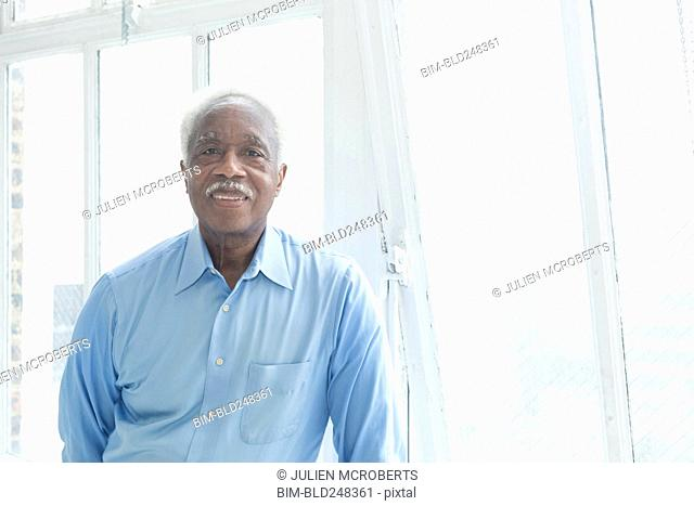Smiling older Black man near the window