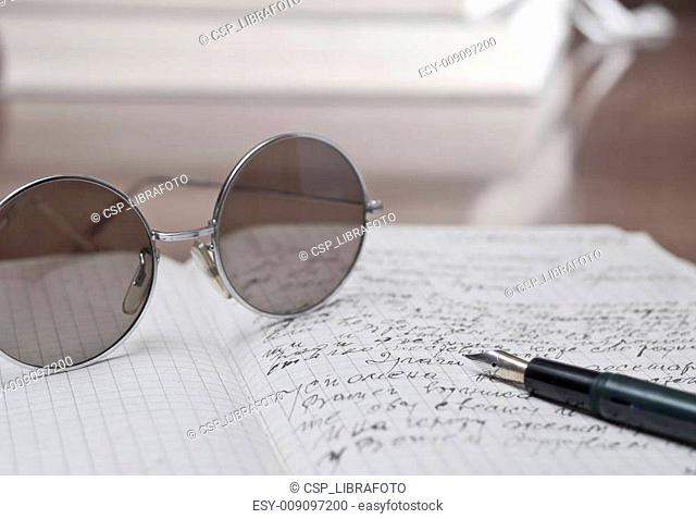 old eyeglasses and book