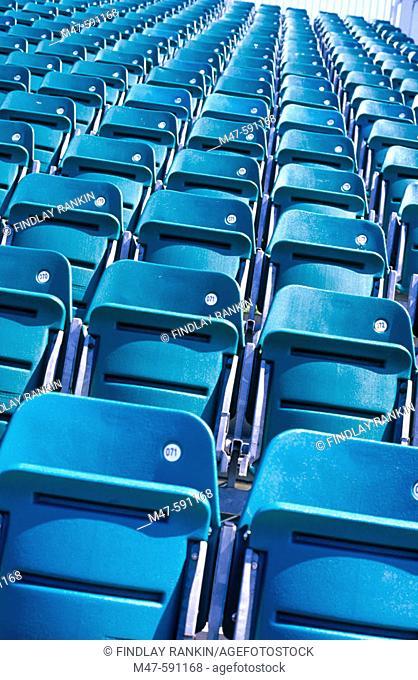 Empty grandstand seats up