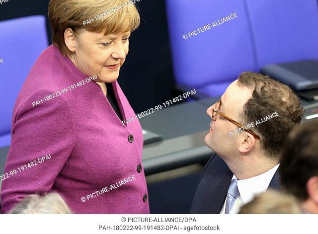 22 February 2018, Germany, Berlin, German Bundestag session: German Chancellor Angela Merkel of the Christian Democratic Union (CDU) has a conversation with...