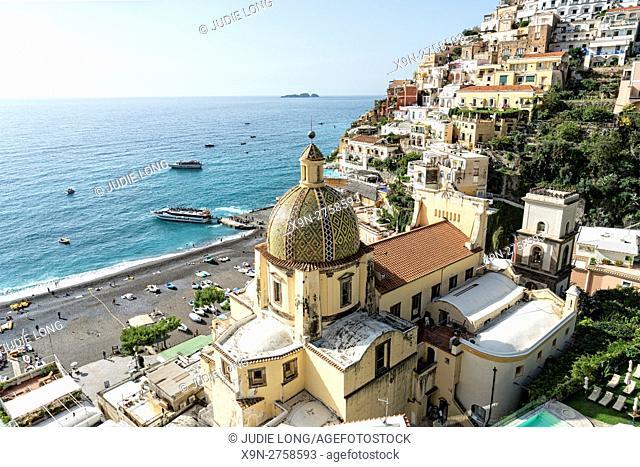 Looking Down at Chiesa di Santa Maria Assunta, a Church with a Majolica-tiled dome, the beach seaand surrounding mountainside buildings