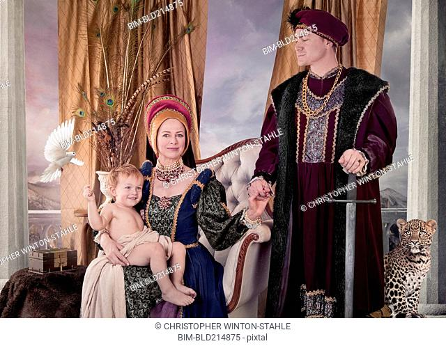 Medieval couple and child posing in living room