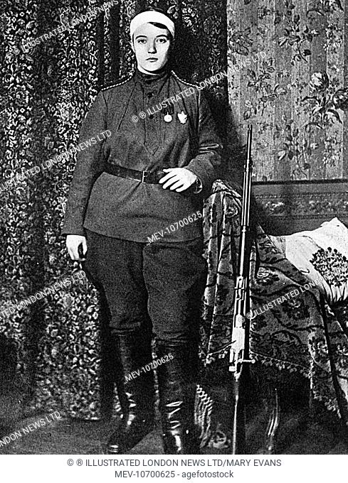Madame Kokovtseva, of the 6th Ural Cossack Regiment with her head bandaged after being twice wounded in East Prussia. One of 400 Russian women bearing arms...