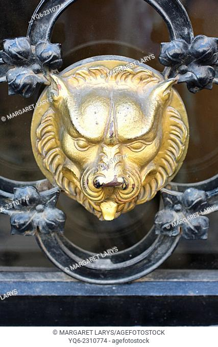An old golden beast on the medieaval gate in Krakow, Poland