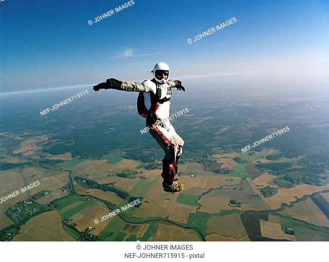 A parachute jumper in the air, Sweden