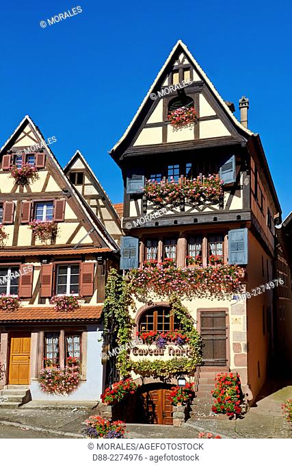 France,Alsace,Bas-Rhin (67),Wine Route,Dambach town,facade of two houses,tavern (Martz) and cottage,windows with flowers