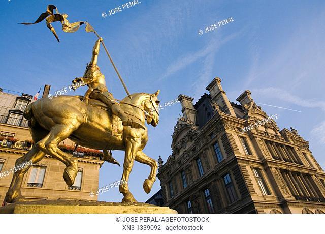 Statue of Joan of Arc, Rue de Rivoli, on background Louvre, Paris, France, Europe