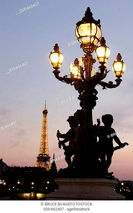 The lamp of Pont Alexandre III with Eiffel Tower in the background. Paris. France