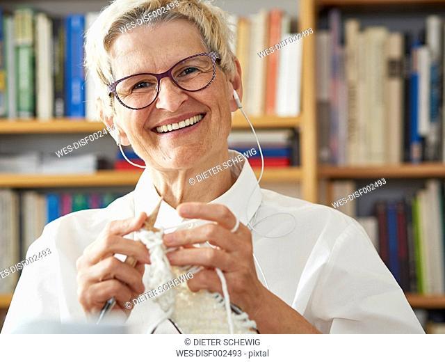 Portrait of knitting senior woman