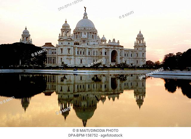 Victoria Memorial reflection in water at sunset ; Kolkata ; West Bengal ; India