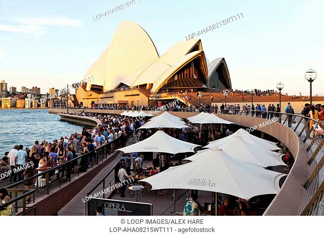 People meeting in the bars along the quay side at Sydney Harbour underneath the Sydney opera house