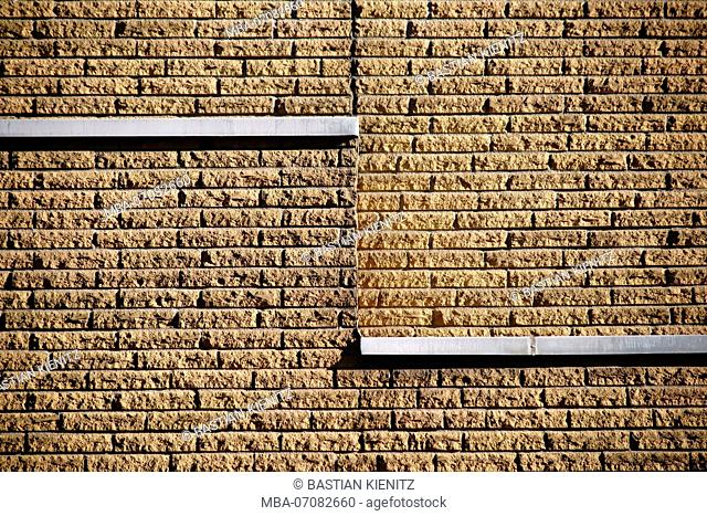 Close-up of a clinker facade made of rough stones on the facade of a building