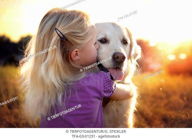girl and Golden Retriever