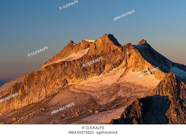 Adamello, Trentino, Italy, Alpenglow in the walls of the Cresta Croce
