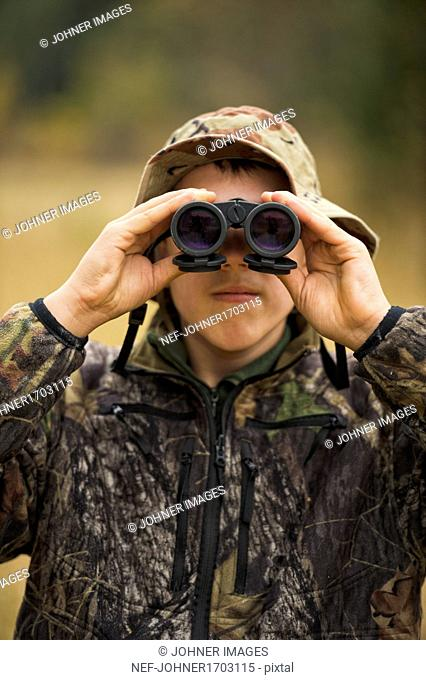 Teenager with binoculars
