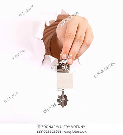 hand holds the keychain through a hole