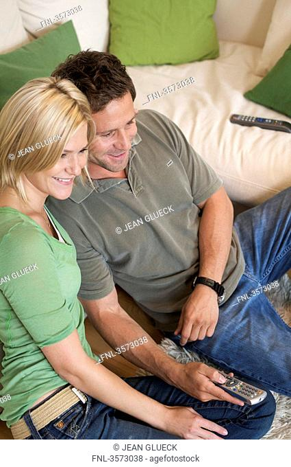 Couple at home watching TV