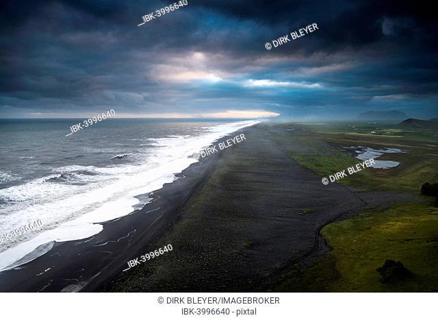 Dramatic clouds, black sandy beach near Dyrhólaey, south coast, Southern Region, Iceland