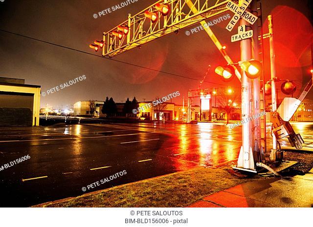 Illuminated traffic lights on railroad crossing at night