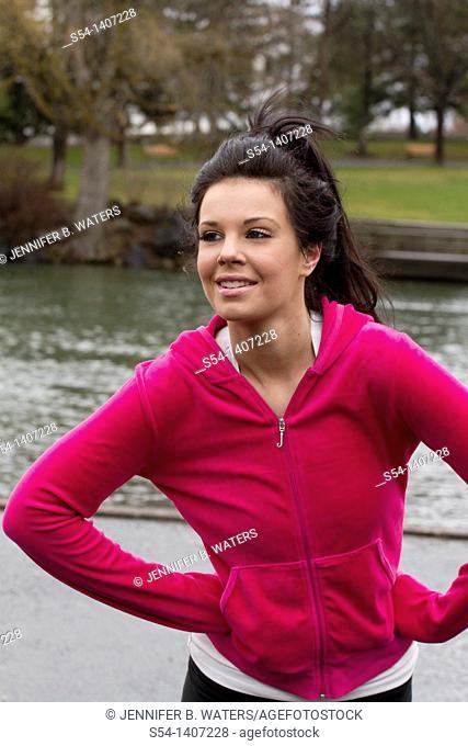 A young woman in workout clothes at Riverfront Park, Spokane, Washington, USA