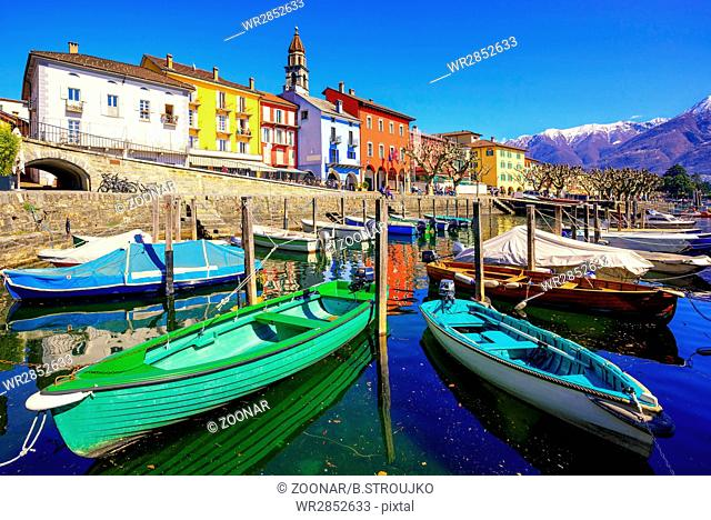 Colorful boats in olt town of Ascona, Ticino, Switzerland