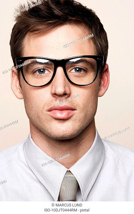 Young man wearing retro glasses
