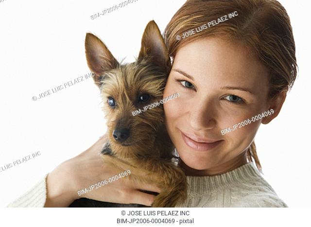 Woman hugging Yorkshire Terrier puppy