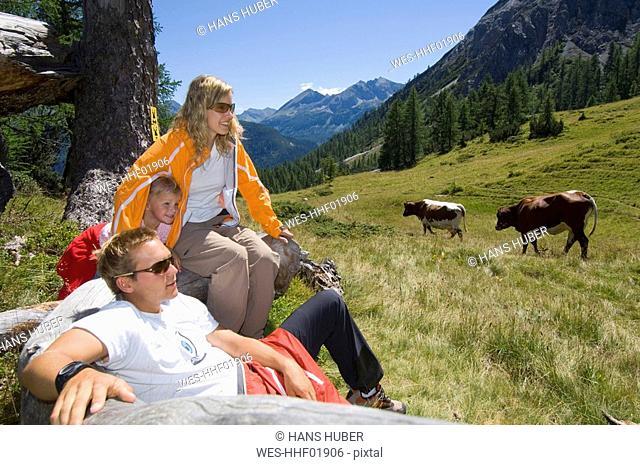 Austria, Salzburger Land, couple with daughter taking a break