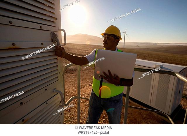 Engineer opening the entrance door of wind mill