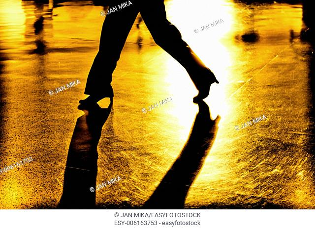 Abstract, creative, digitally altered and toned photo of women legs and shadows