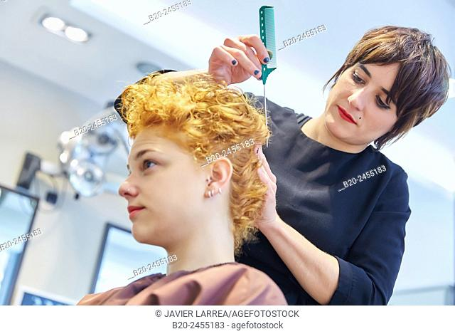 Hairdressers pinning customer's hair. Hairdressing salon and Beauty Clinic