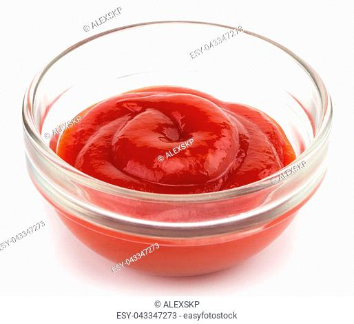 Small glass condiment bowl of red tomato sauce ketchup. Isolated on white