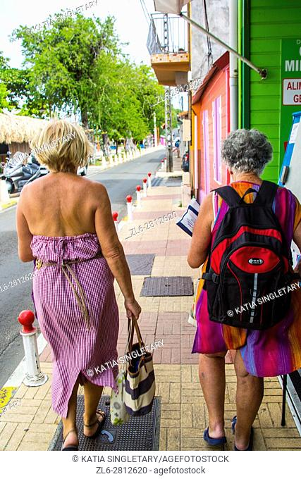 Caucasian retired senior woman going to the local market in the tropical island of Martinique