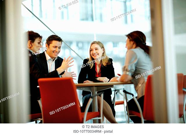 People in a business meeting, smiling