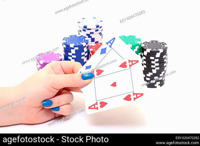 Hand with two Aces and Stacks Poker Chips