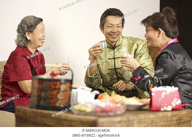 People in living room during Chinese New Year