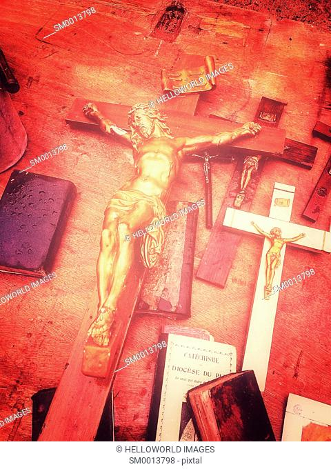 Christ on the cross and religious memorabilia for sale at flea market (marche aux puces), Clermont Ferrand, Auvergne, France, Europe