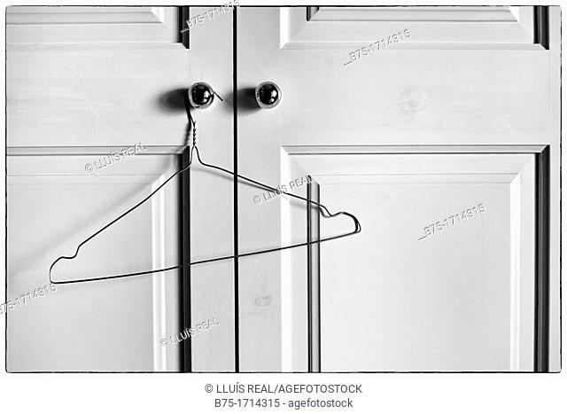 Closet doors closed with empty hanger