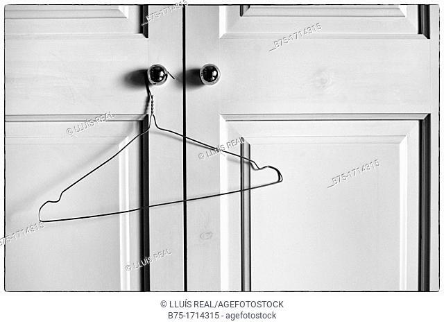 Closet doors closed with empty hanger