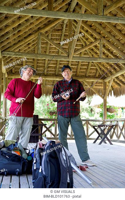 Hispanic friends preparing to go fishing