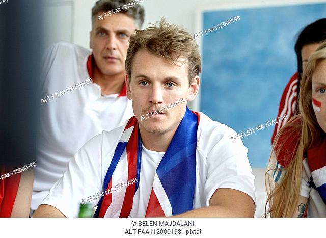 British football fans watching match on TV