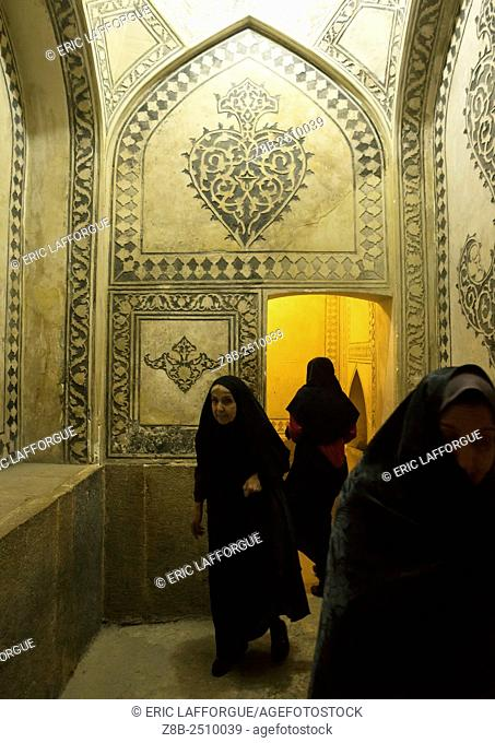 Iran, Fars Province, Shiraz, veiled woman in the karim khan fort bath