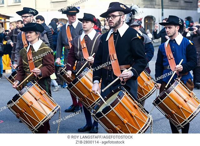 Drum corps marching through the streets of old town Geneva during Escalade