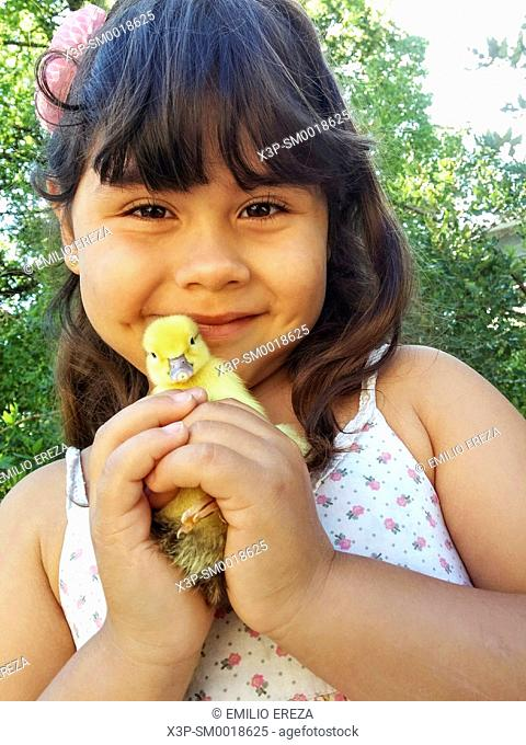 Little girl with duckling