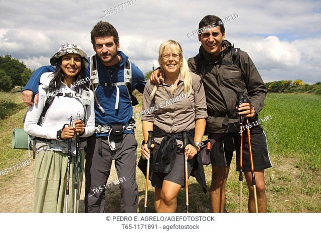 Pilgrims of different nationalities have a picture taken as a memento in his journey along the Camino de Santiago. Sarria, Province of Lugo, Galicia, Spain