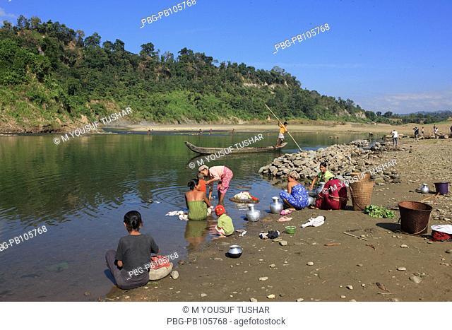 Tribal women washing clothes at the Sangu river at Bandarban, Bangladesh December 2009