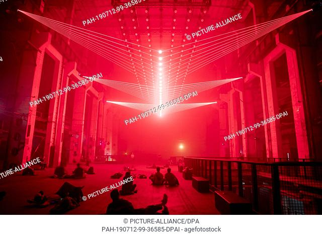 "12 July 2019, Berlin: Visitors to Kraftwerk Berlin will take a look at the audiovisual installation and live performance """"DEEP WEB"""" by light artist..."