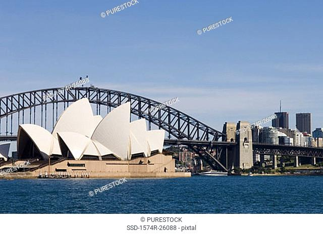 Opera house on the waterfront near a bridge, Sydney Opera House, Sydney Harbor Bridge, Sydney, Australia