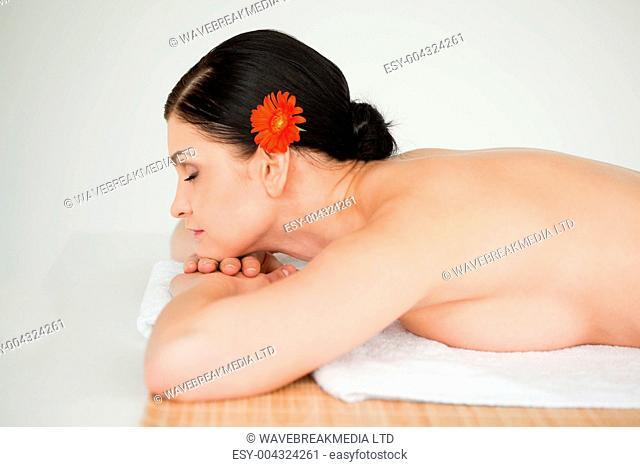Brunette relaxing lying down